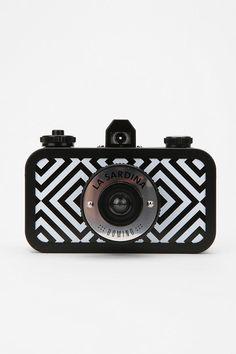 La Sardina lomo camera - so awesome! Takes 35mm film and comes in cool patterns AND is less than $50. Definitely want!!