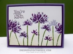 Too Kind sample with spritzed water colored flowers from inkingoutofthebox.com