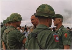 President Lyndon B. Johnson, with General Westmoreland, MACV officer commanding, decorating soldiers in Vietnam, October 1966. The drama was unfolding.