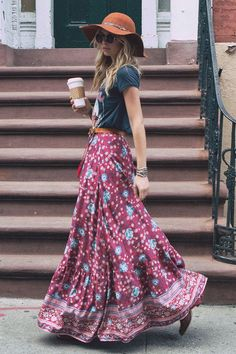 Graphic tee tucked into maxi skirt plus belt and hat.