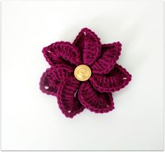 Decisions… Decisions…  Just crocheted a fuchsia flower. One of my favorite colors. Should I  wear this on my  hair? On a straw hat? On a tote bag? As a brooch for my  jacket or should  just give this one away (as usual) and let someone  else decide?  Here goes the free pattern for a Croco-Flower.   It's quite easy and gives you an interesting 3-D effect.  It can be  worked in any yarn weight.  However, heavier weight yarns like  worsted or bulky weights works best to give it a sturdier