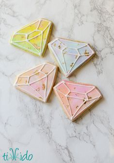 Gemstone shaped watercolor style sugar cookies decorated with royal icing and gold leaf, made for our beloved Irish step dancing teacher.
