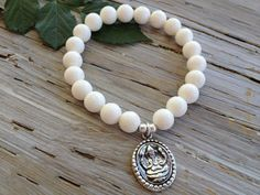 """$58 - WHITE SPONGE CORAL GANESHA BRACELET    """"You're imperfect, and you're wired for struggle, but you are worthy of love and belonging."""" -Brené Brown  Timeless white sponge coral and sterling silver ganesha charm bracelet. Stretch bracelet measures 7"""", sized to fit most wrists."""