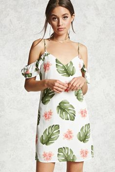 A woven mini dress featuring an allover tropical print, an open-shoulder design, V-neckline, cami straps and an elasticized back strap, tiered ruffle sleeves, a concealed back zipper closure, and a shift silhouette.