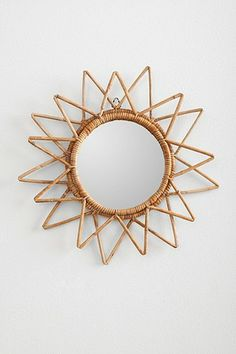 I'd paint the wicker gold...Magical Thinking Woven Wall Mirror $24 at UO