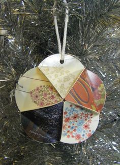 Recycle Christmas cards to make ornaments.