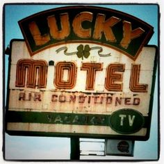 Lucky Motel ~ Old Neon Sign with a Shamrock