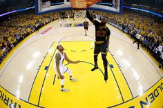 LeBron James Photos Photos - LeBron James #23 of the Cleveland Cavaliers dunks the ball against the Golden State Warriors in Game 2 of the 2017 NBA Finals at ORACLE Arena on June 4, 2017 in Oakland, California. NOTE TO USER: User expressly acknowledges and agrees that, by downloading and or using this photograph, User is consenting to the terms and conditions of the Getty Images License Agreement. - 2017 NBA Finals - Game Two