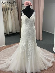 A romantic mermaid style, with a v neckline, illusion lace shoulder straps, a lace bodice and hips, cascading lace motifs, finished with a low illusion lace back. Zip back and buttons. Discount Designer Wedding Dresses, Mermaid Style, Lace Bodice, Lace Back, Dream Wedding Dresses, Bridal Boutique, Shoulder Straps, Illusion, Townhouse