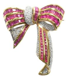 Three-dimensional ribbon bow form, approximately 51 pavè bead set round brilliant-cut diamonds, estimated combined diamond weight 1.0 cts., 74 specialty square and rectangular step-cut genuine rubies, estimated ruby weight 1.50 cts., 18 kt. yellow gold mount, 37.5 x 30.5 mm., 11.2 grams gross weight