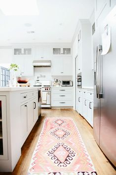 Vintage Turkish and Persian rugs look best in simple spaces, adding just the right pop of color and pattern. Think crisp white walls, white marble countertops, unfussy cabinetry, and simple backsplashes.