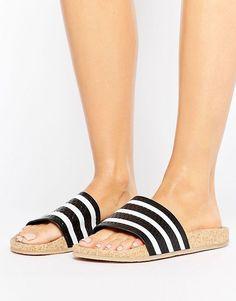 c0994e97a85c05 Shop adidas Originals Adilette Slider Sandals Wth Cork Sole at ASOS.