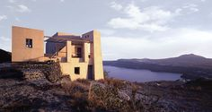 seemingly carved from the ground, the isolated house atop a cliff exhibits santorini's past in a contemporary context.