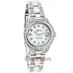 This Rolex Datejust Ladies Custom Diamond Watch features 7.25 carats of genuine diamonds