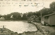 Akershus fylke Frogn kommune Drøbak. Bryggemiljø bortover. Bl.a. hus m/badegjester. Brukt 1927 Produsent/foto J.H.Küenholdt