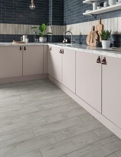 The Tabula™ fog tile is shaped into a small plank. While produced from a mid grey porcelain for simple maintenance, the grained, matt finish mimics the texture of real wood. Kitchen Flooring Options, Best Flooring For Kitchen, Flooring Ideas, Wood Effect Floor Tiles, Tile Care, Polished Porcelain Tiles, Topps Tiles, Multi Fuel Stove, Tile Stores