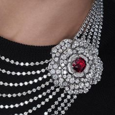 At the center of the camellia on the Rouge Incandescent necklace is a Mozambique ruby, which detaches to reveal a second… The Rouge, High Jewelry, Camellia, Coco Chanel, Crochet Necklace, Pendant, Flower, Winter, Instagram