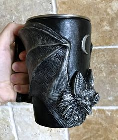 Sculpted Vampire Bat mug, 5.5 tall, cast in a food grade resin and hand painted with a stainless steel cup insert, 16oz.  Good for both hot and cold beverages- steel cup is removable and is dishwasher safe, Resin mug is hand wash only.