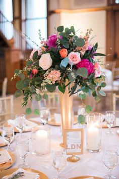 Tall floral arrangements are always a pretty way to decorate your tables! Captured by Jessica Gold Photography #bridesofnorthtx #wedding #centerpiece