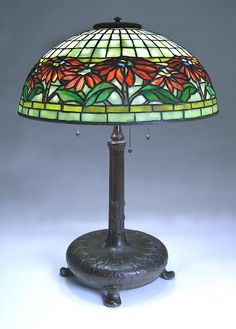 """Tiffany Studios, New York, Favrile Leaded Glass and Patinated Bronze """"Poinsettia"""" Lamp."""
