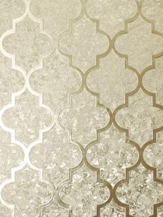 This beautiful Velvet Foil Trellis Wallpaper will bring a touch of glamour and style to any room. The design features a geometric trellis pattern in a soft gold shade, overlaid on a seemingly abstract pattern of different subtle textures that work together to give the appearance of crushed velvet in the same champagne gold tone, with a high shine metallic foil finish. This paper is designed to catch and reflect the light to give you a different look depending on the viewing angle and… Hall Wallpaper, Dining Room Wallpaper, Trellis Wallpaper, Feature Wallpaper, Metallic Wallpaper, Paper Wallpaper, Vinyl Wallpaper, Taupe Living Room, Living Room Green