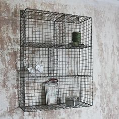 Treat your walls to some stylich storage with these wire locker room shelves in distressed grey and