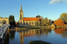 All Saints Church in Marlow, Buckinghamshire. The church was built in 1835 and has a 170 foot spire and is situated on the banks of the River Thames, next to Malow suspension bridge.