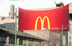 A custom commercial metal billboard extension fabrication and installation for a McDonald's campaign in downtown Chicago.