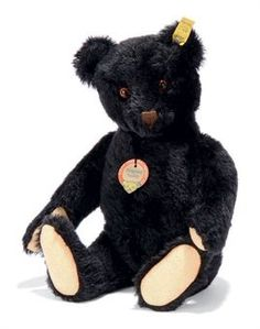 A STEIFF BLACK ORIGINAL TEDDY, (5335,95), jointed, mohair, black and brown glass eyes, brown stitching, inoperative squeaker, script button, yellow cloth tag and chest tag, 1953 --12¾in. (32.5cm.) high