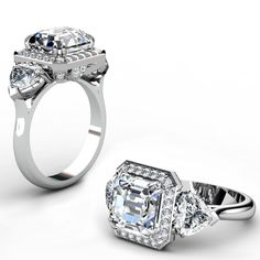 4Ct Asscher cut diamond center stone with halo.  Heart shapes diamonds on the shoulders.