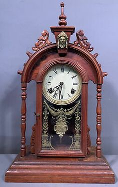 This is a nice looking 100+-year-old Antique wooden kitchen style mantle clock featuring a brass ormolu lady bust at the top. Both the key and the pendulum are present and the clock does not appear to be wound tight. Old Kitchen, Wooden Kitchen, Mantle Clock, Old Antiques, Victorian Era, Clocks, Brass, Key, Nice