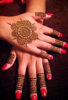 Beautiful mandala mehendi with pink nail paint | wedding inspiration | wedfine.com