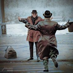 """""""West meets East"""" - Two german brothers , separated by The Berlin Wall, meet again during the """"border pass agreement"""" of 1963.  Photo credit: Ian Berry"""