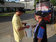 """WCHS & WVAH TV """"Hope in Oklahoma"""" boot drive #OKstrong May 30, 2013 @patmcmurtryWCHS and Photographer Bob Frank checking out the numbers"""