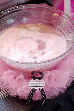 This tutu-adorned punch bowl would make for a great focal point for a ballerina party. Just add one of your yummy pink punch recipes and you're good to go. @Alicia T T Parker you should do this in blue for Ava's party. I may have a punch bowl, but I'm sure @Leann T T Ouwinga does. You could even make blue punch to go in it! :)