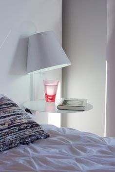 This light is the perfect solution for small spaces thanks to its multiple functionality:a bedside table,an occasional table,or a hallway lamp.  Alux takes the idea of a table lamp to the most literal conclusion, incorporating both terms in one product.