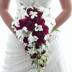 red roses and white lillies with a hint of unstructured greenery