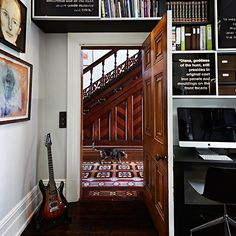 We lovet this built in bookcase filled with art and eclectic finds