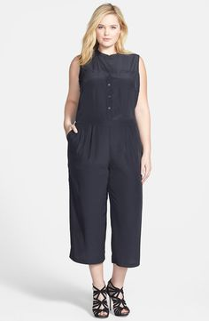 A silky sleeveless jumpsuit provides a sophisticated alternative to a dress while retaining the ease of a one-piece. This version is both flattering and polished with a band-collar bodice and a figure-nipping inset waist balanced with wide, cropped legs.