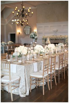 Gold Ivory And White Wedding Reception Decor With Florals In Glass Vessels Place Settings Of Rimmed Crystal Char