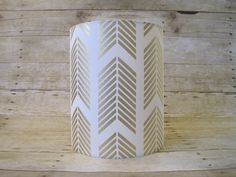 Lamp Shade Drum Lampshade made with Caitlin Wilson Gold Arrows Fabric - READY TO SHIP Description: Make a refined statement with this modern drum shade featuring Caitlin Wilsons gold arrow pattern. Colors include metallic gold on a white background. The lampshade is 100%