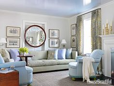 """After his client downsized to a smaller house in Summit, New Jersey, designer Kevin Isbell accommodated her 12-foot-long sofa in the living room by putting it against a wall with a doorway. To """"defuse the fact,"""" he hung her showstopping 19th-century sorcerer's mirror above it, creating the feeling of a solid wall."""