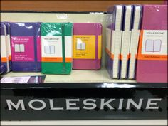 Moleskine is available in branded shelf-edge in mass merchandising situations as well as its own specialty stores and online. Moleskine, Logo Branding, Retail, Storage, Color, Black, Colour, Black People, Larger