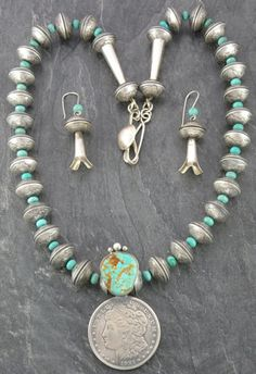 Necklace & Earrings | James McCabe (Navajo). Sterling silver , turquoise and silver coin