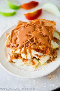 "Gooey brie quesadillas stuffed with thinly sliced apples and topped with an easy 2-ingredient caramel sauce. These are the perfect ""anytime"" food."