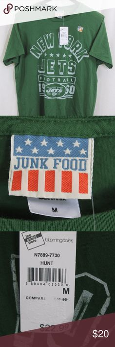 """JUNK FOOD NEW YORK JETS T-SHIRT MED NWT SIZE:   MEDIUM  ARMPIT-TO-ARMPIT:   20""""  LENGTH DOWN BACK:    27""""  STYLE:     T  MATERIAL:    COTTON  CONDITION:        BRAND NEW W TAGS. SOURCED DIRECTLY FROM A NATIONAL UPSCALE U.S. RETAILER. QUALITY AND AUTHENTICITY GUARANTEED!         52-109-M31 Junk Food Clothing Shirts Tees - Short Sleeve"""