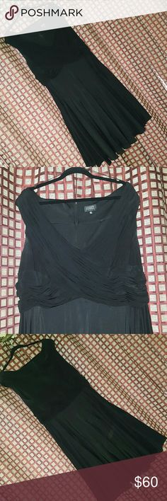 "22W Black Plus Adriana Papell Dress Plus size cocktail dress from Adrianna Papell.  Black stretchy top with taffeta bottom.  Eye-catching ruched crossover elevates this taffeta dress.  V-neck. Ruched crossover bodice.  Cinched at waist. Pleated skirt. Concealed back zip closure. About 39"" from shoulder to hem.  Brand:  Adrianna Papell Size:  22W Color:  Black  Top Material:  95% Polyester, 5% Spandex Bottom Material:  50% Polyester, 45% Nylon, 5% Spandex Care:  Dry Clean  Worn once. Great…"