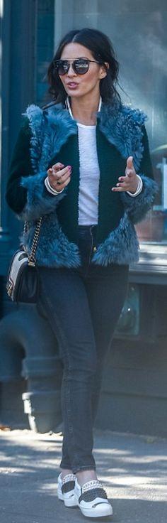 Who made Olivia Munn's green bomber jacket, white studded sneakers, and handbag?