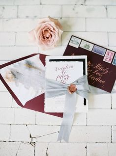burgundy fall invitation with vintage postage stamps and silk ribbon, wax seals by One + Only Paper