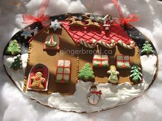 "Gingerbread Advent Calendar  Each cookie is removable and numbered from 1 to 24....  on Christmas you eat the WHOLE house cookie (sized 15"" x 11"")."